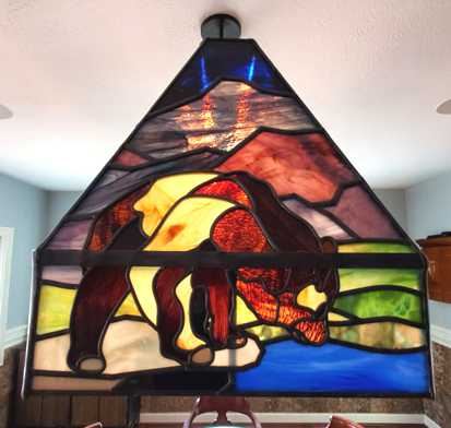 bear stained glass lampshade lit